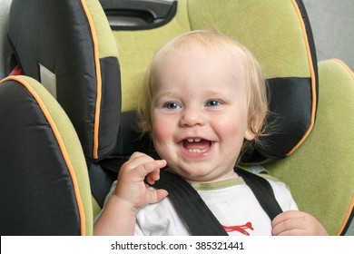 baby fastened to the child car seat