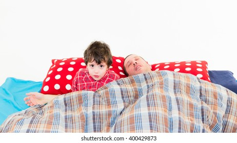 Baby and father together on the bed