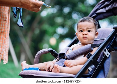 Baby feeling angry in stroller. baby concept.