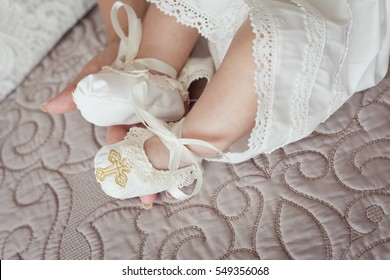 Baby feet in mommy's hand. Christening. Baptism. Orthodox