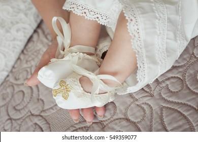 Baby feet in mommy's hand. Christening. Baptism. Orthodox