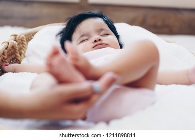 Baby feet in mother's hands