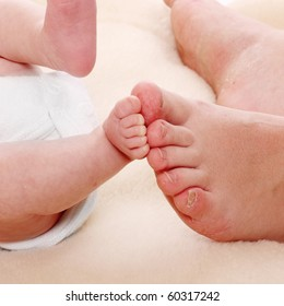 Baby feet and mother's feet. Little and big.