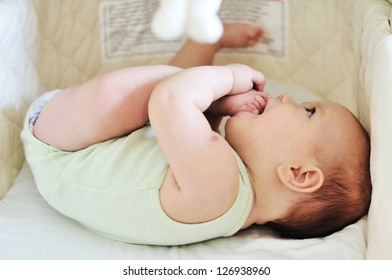 baby with feet in mouth