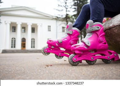 baby feet in pink rollers on a beautiful background
