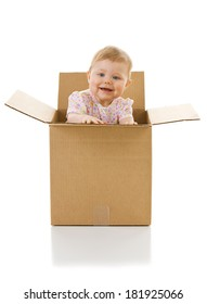 Baby: Female Baby Playing Inside Cardboard Box