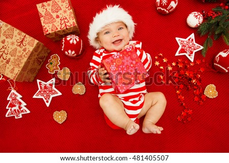 60ee01740563f Baby first christmas. Beautiful little baby celebrates Christmas. New  Year s holidays. Baby with