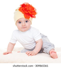 Baby with a flower hat on. Beautiful happy baby . One,isolated on white.