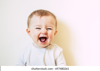 Baby with flu laughing
