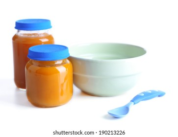Baby food in glass jars, isolated on white