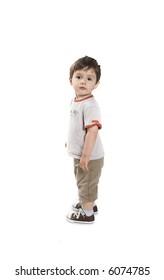 baby full body shot standing over white
