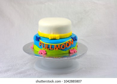 Baby full-moon party cake covered with fondant and written full moon. Full moon baby party is to celebrate the new born family member. and also marks the end of the new mother's confinement.