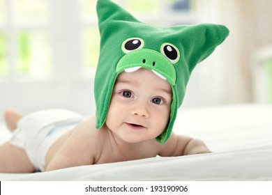 Baby with funny cap on head