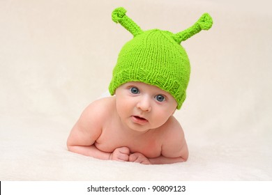 baby in funny green Christmas hat