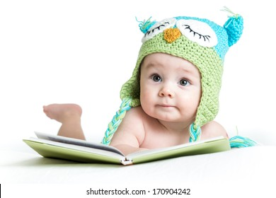 baby in funny owl knitted  hat owl with book  on white background