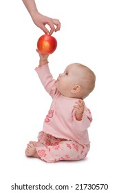 Baby gets an apple from mother