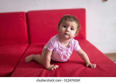 baby gets off the couch, early concept development, security. Cozy house, lifestyle, selective focus,