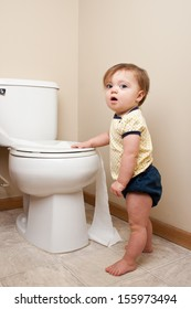 Baby getting caught getting into toilet paper
