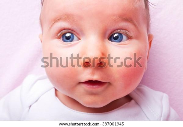 baby-girl-600w-387001945.jpg