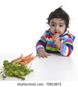 Baby Girl Attempting to Eat Carrot, Isolated, White