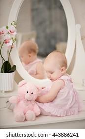 Baby girl and bear
