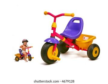 baby girl   - big and small bike