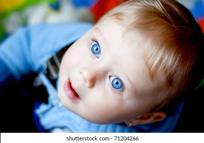 Baby girl with blue eyes looking at the camera