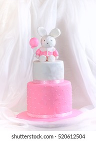 Baby girl cake for first Birthday with rabbit & balloon