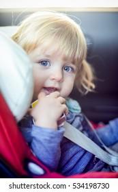 Baby girl in car seat.