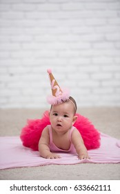Baby Girl Celebrates Her Six Months Old Day wearing Pink Tutu and Party Hat