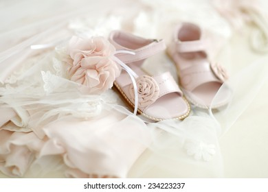 Baby girl christening shoes and flower headband