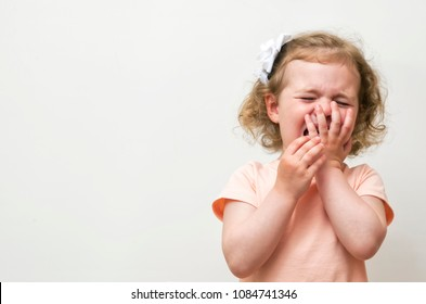 Baby Girl crying over white background