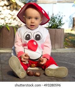 Baby girl dressed like a mushroom