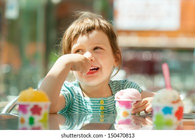 baby girl eating ice cream  in summer