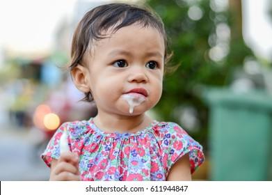 Baby girl eating ice-cream