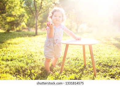 Baby girl eating watermelon. Fruit, childhood, healthy eating, play, outdoors
