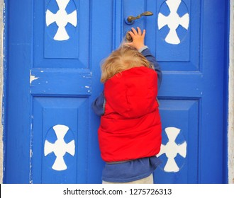 Baby girl entering to a church, Greece