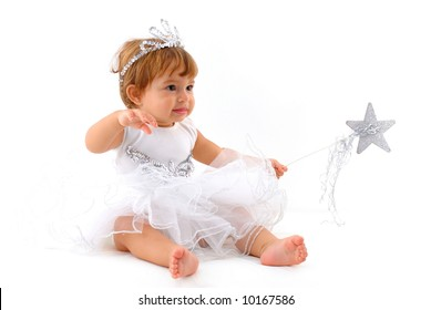A baby girl in a fairy dress, wearing a crown, white background.