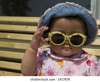 baby girl with hat and sunglasses