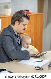 A baby girl is helping his businessman dad calculate something. She is helping him at his work.