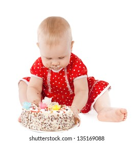 Baby girl and her birthday cake, studio