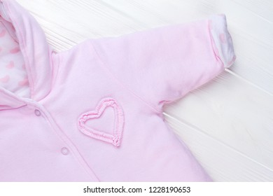 Baby Girl Hooded Fleece Jumpsuit. Pink winter clothes, close up.