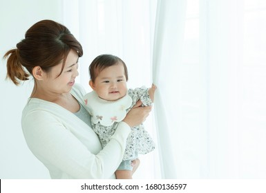 Baby girl hugged by mother