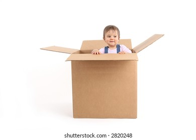 baby girl inside box, smiling