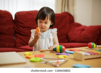 baby girl learning numbers at home