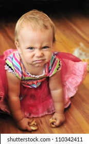 baby girl make funny face in soft selective focus