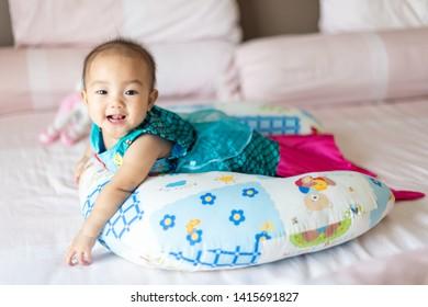 The baby girl in mermaid swimming suit