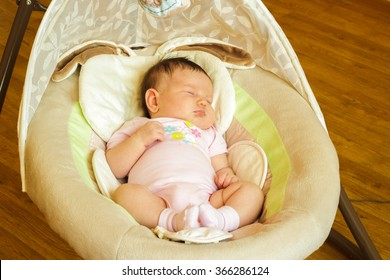 Baby girl newborn sleeping in the cradle