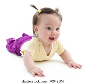 Baby girl on her stomach. Picture on a white background.