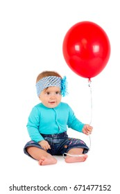 Baby girl on white background with balloon
